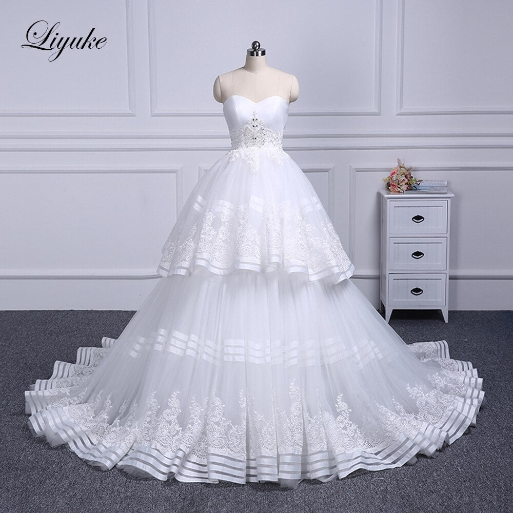 Liyuke Strapless Of  A-Line Wedding Dress With Tiered Skirt Of Court Train Wedding Gown