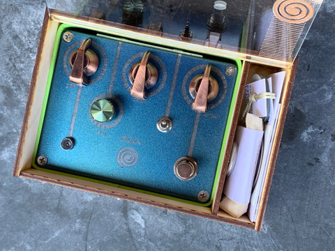 Hand build guitar effects pedals in a beautiful cyan finish