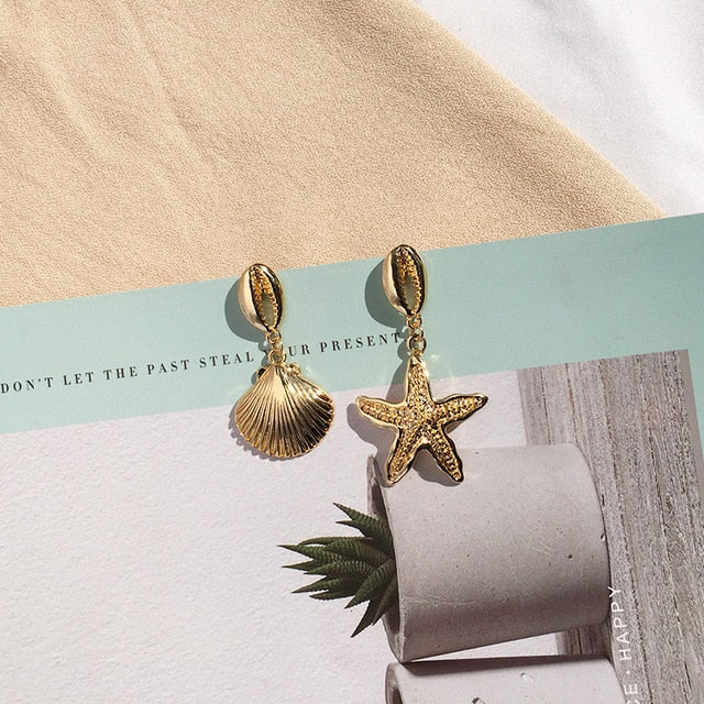 Gold Sea shell drop Earrings - Disney Voguette