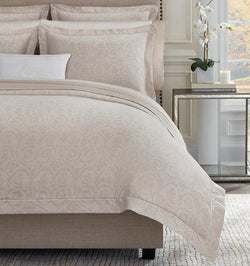 Soft rose and white yarns create an elegant jacquard weave on SFERRA's Amiata Duvet Cover.