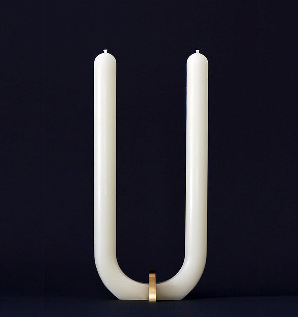 U Candle by Glaze Studio is a hand-poured, dual burning candle made of 100% white beeswax, sold by SFERRA.