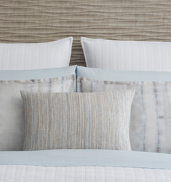 SFERRA Minori decorative pillow is characterized by a strié of blue, grey and stone-colored stripes, inspiring a relaxed look of depth and feel.