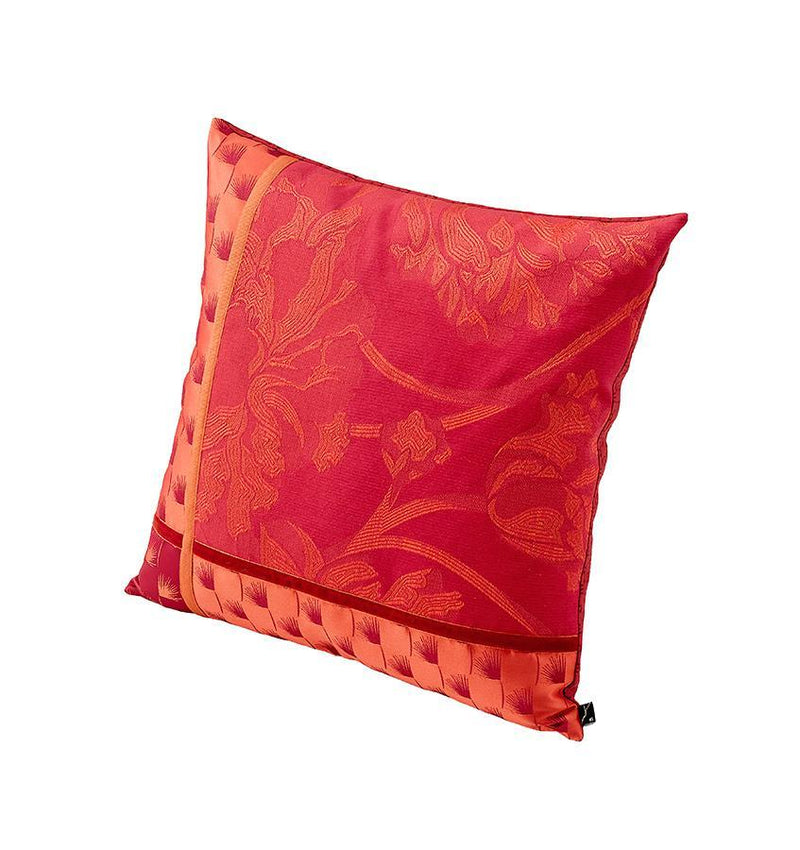 The K3 for SFERRA Pivoine Cushion is designed with a patchwork of red and orange jacquard patterns.