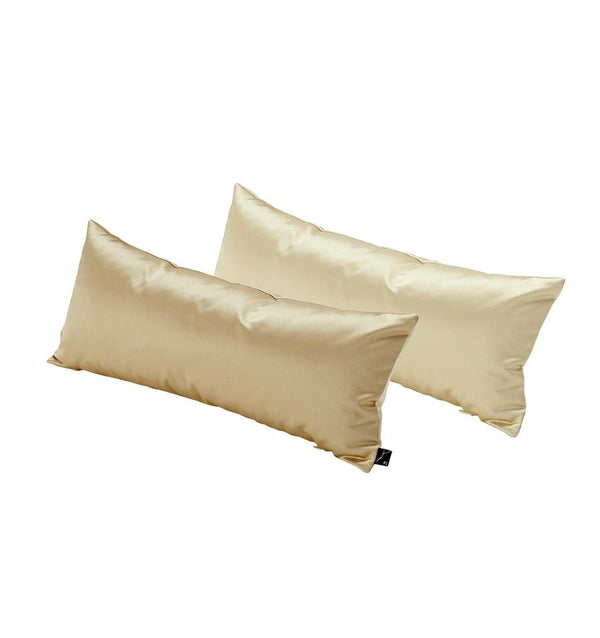 A play on size and scale, the Satin Cushion is an oblong satin pillow giving off a captivating sheen.
