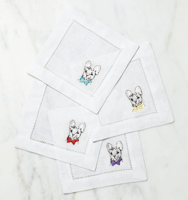 SFERRA Cani cocktail napkins feature Dalmatians, French Bulldogs, and Gold Retrievers on hemstitched linen napkins.