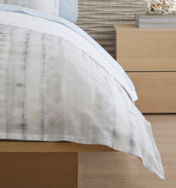 SFERRA Cossita Duvet Cover features muted gradient tones of blues, grey and taupe printed onto a silky sateen base.