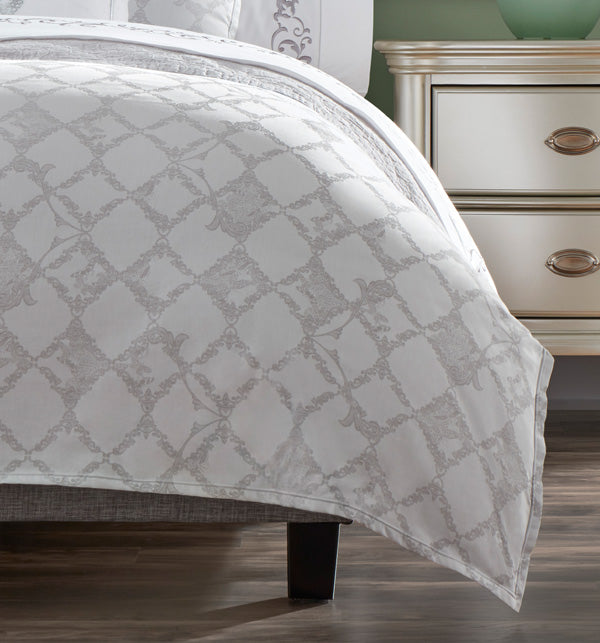 The SFERRA Farfalla Duvet Cover is designed with delicate scrollwork details and faint butterflies on an ironwork motif.