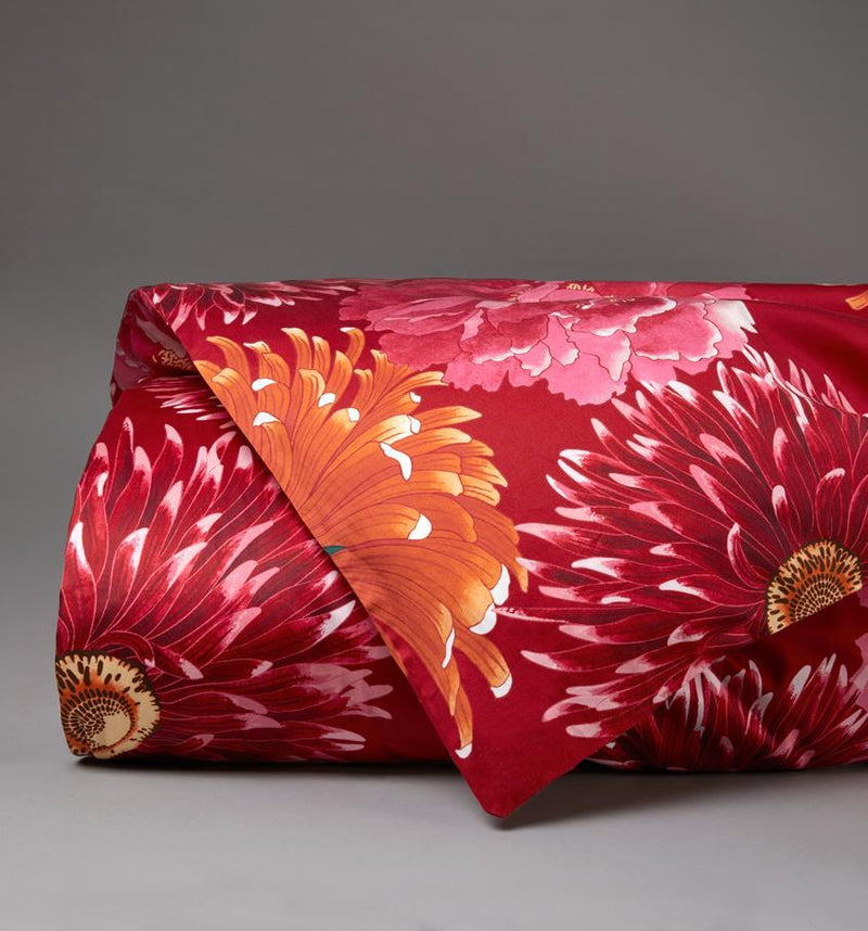 Hanabatake Duvet Cover is printed on an exquisite Italian sateen with dramatic red, pink and orange florals.