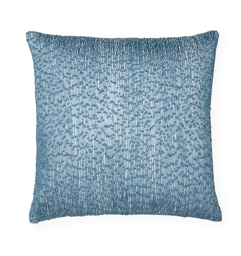 Lesina  decorative  pillow  features  embroidered  threads  woven on a crisp white cotton-linen base.