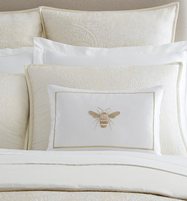 SFERRA Miele Decorative Pillow is embellished with an intricate golden bee motif in Zardozi embroidery on a luminous silk satin-base.