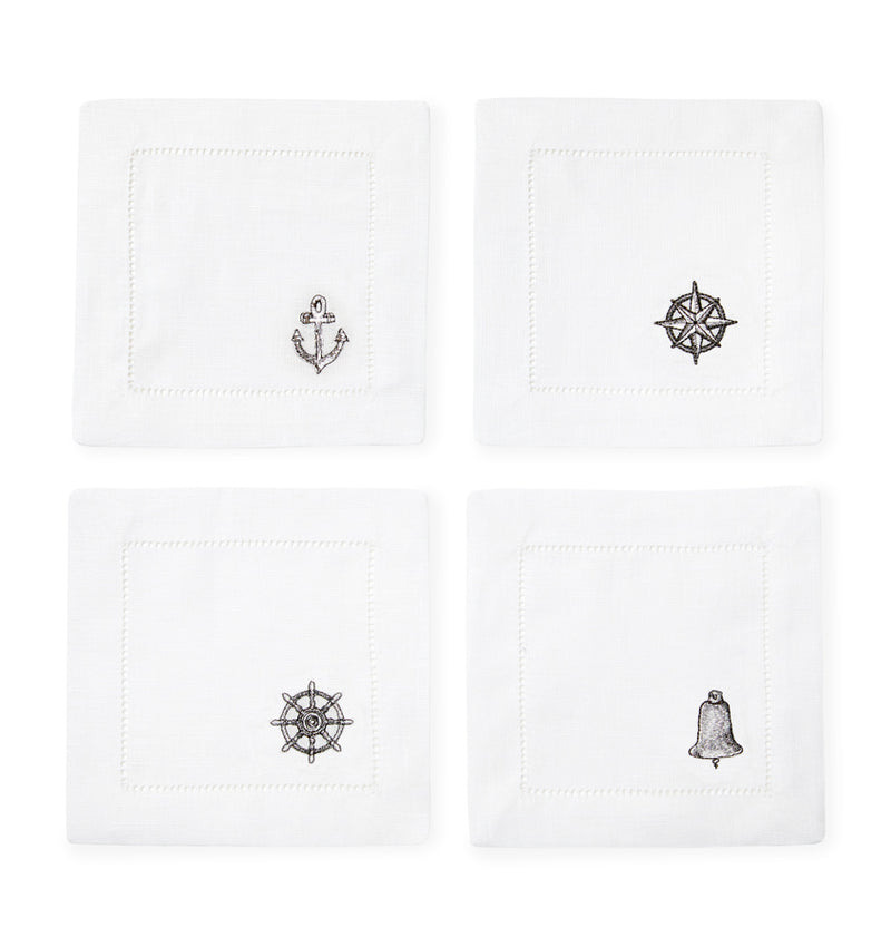 SFERRA Nautico cocktail napkins feature coastal themes on white hemstitched linen napkins.