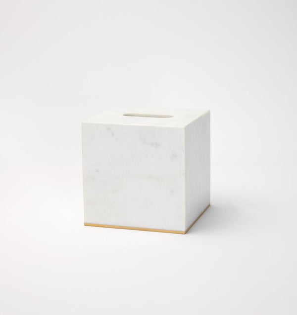 Gold-trimmed white marble tissue holder against a white background.