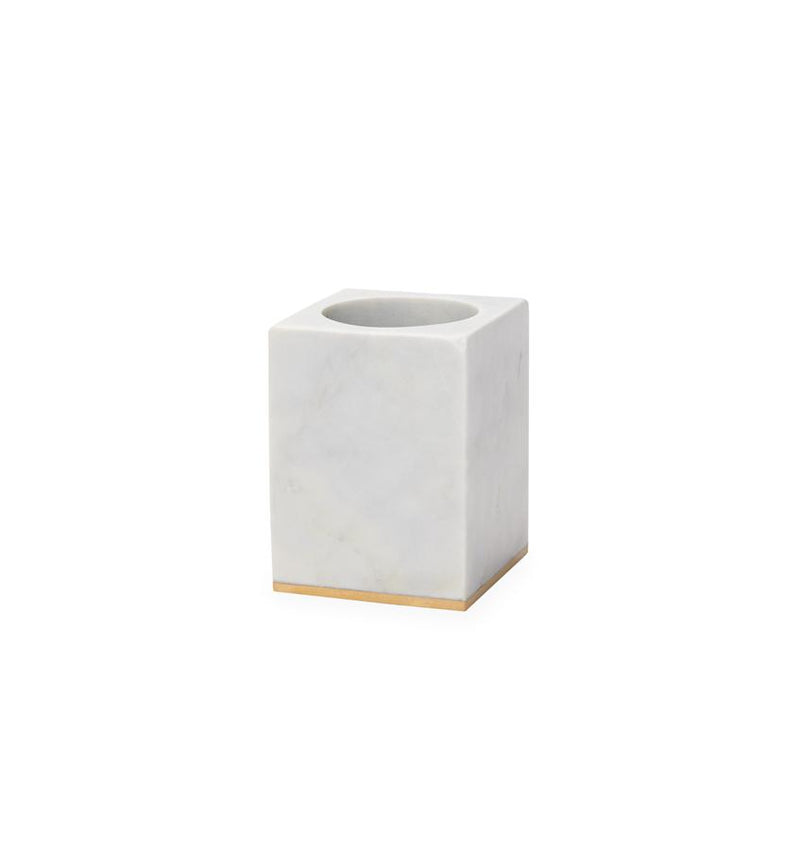 Gold-trimmed marble toothbrush holder against a white background.