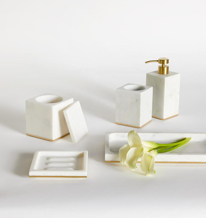 Gold-trimmed white marble SFERRA bath accessories against a white background.