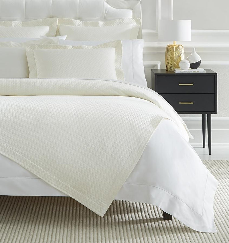 A luxury SFERRA bed skirt with a diamond piqué pattern. The Bari Collection is available in an array of pastel colors.