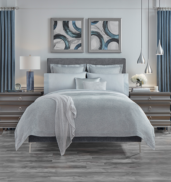 The Gocce Duvet Cover is designed with vivid fluidity, while the soothing coloration of aqua and white is rendered in a subtle ripple effect.