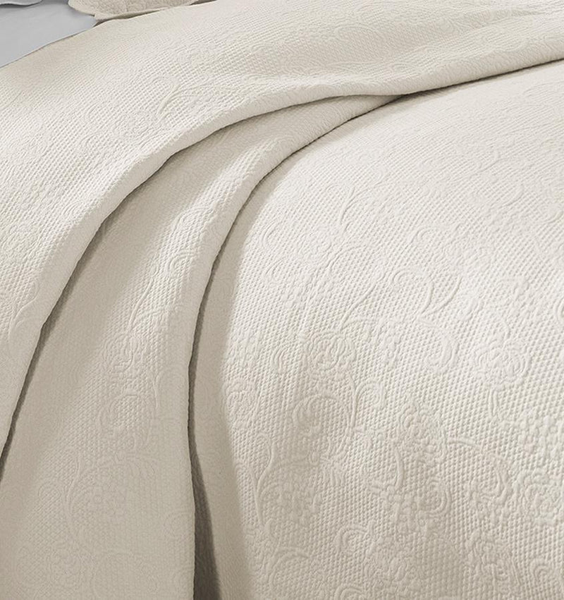 SFERRA Alice Coverlet in beige matelassé, a subtle raised pattern of flowers and vines is woven from the softest of cottons.