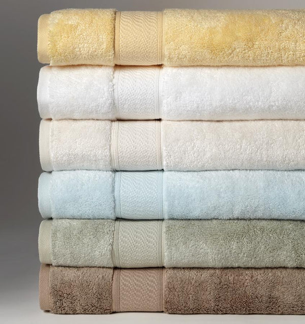 A stack of multi-colored SFERRA Amira luxury bath towels.