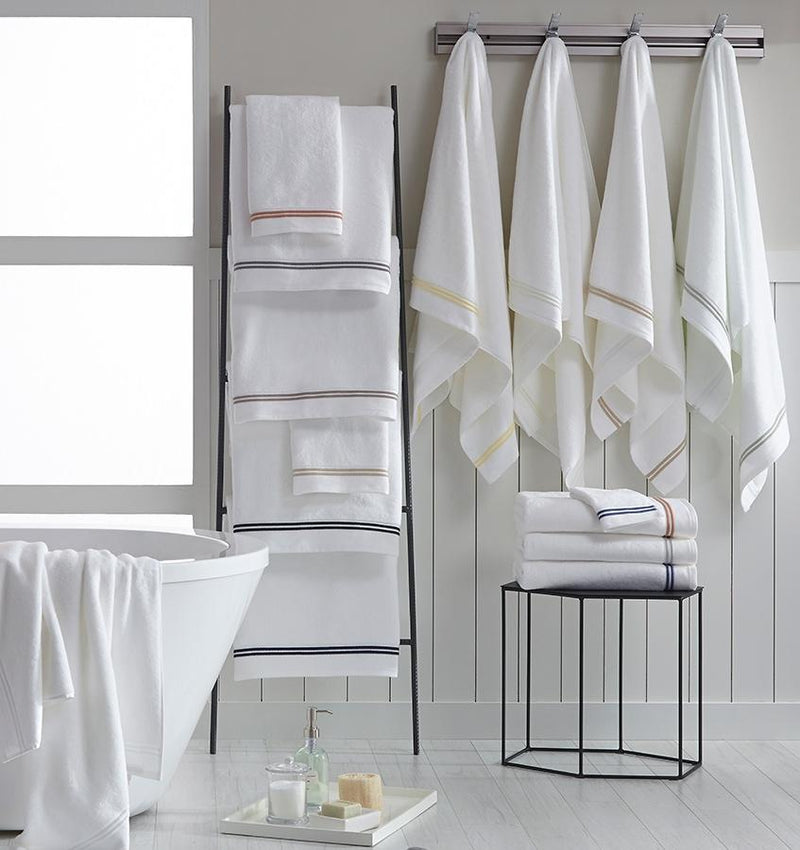 SFERRA Aura bath towels with multi-colored embroidered striped borders.