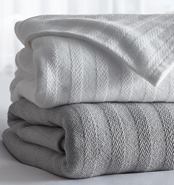 The SFERRA Bessini classic cotton, lightweight blanket with the sophistication of a textured, tonal stripe. Made in the USA.