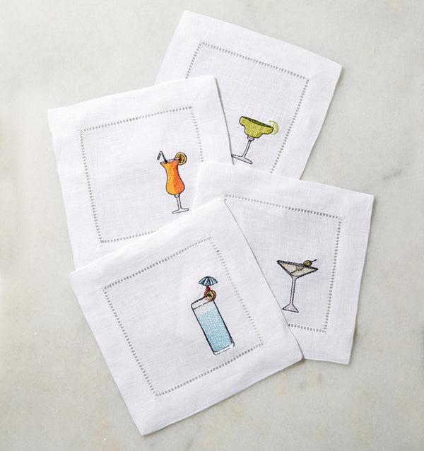 SFERRA Bevande cocktail napkins feature a Martini, Margarita, Orange Crush and Blue Hawaiian on hemstitched linen napkins.