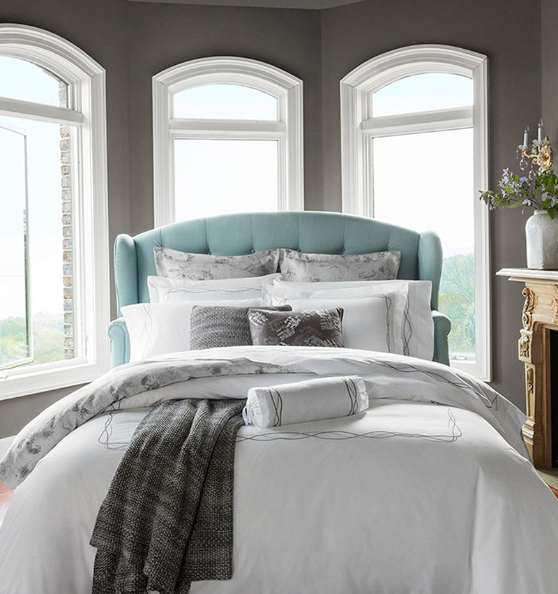 Cade's undulating satin-stitch embroidery lends a sense of play to a classically crisp bedding crafted from our Grande Hotel percale sheets.