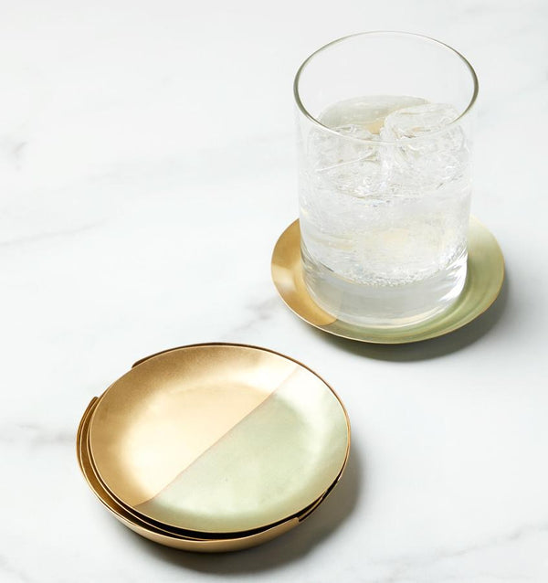 SFERRA Campania Coasters are two-toned, brass coasters are handcrafted with earthy hues and a matte finish.