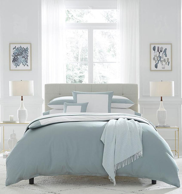 Casida Duvet Cover is minimal with its contrast color border in sateen appliqué along one side, and solid sateen on the reverse.