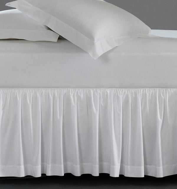 A luxury SFERRA bed skirt in crisp Italian cotton percale. The Celeste Collection is available in an array of colors.