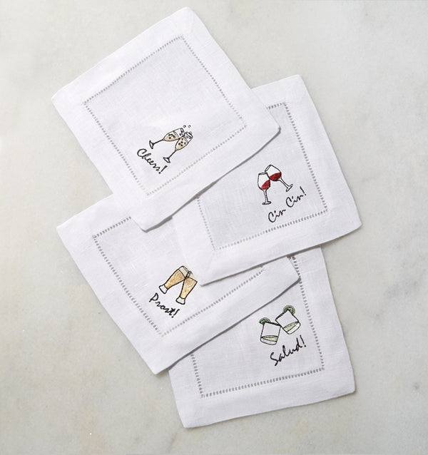 SFERRA Cheers cocktail napkins feature a cheerful selection of four drinks on hemstitched linen napkins.