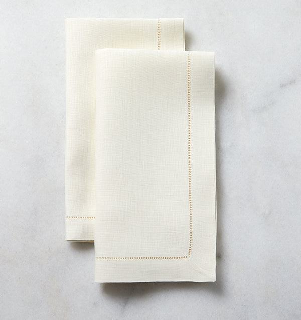 The SFERRA Classico napkin is our finest linen, woven with a border of delicate, refined hemstitching. Each thread is drawn by hand creating heirloom table linens to last for generations.