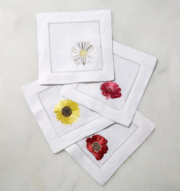 SFERRA Fiori cocktail napkins feature floral embroidery of the most cheerful blossoms on white hemstitched linen napkin.