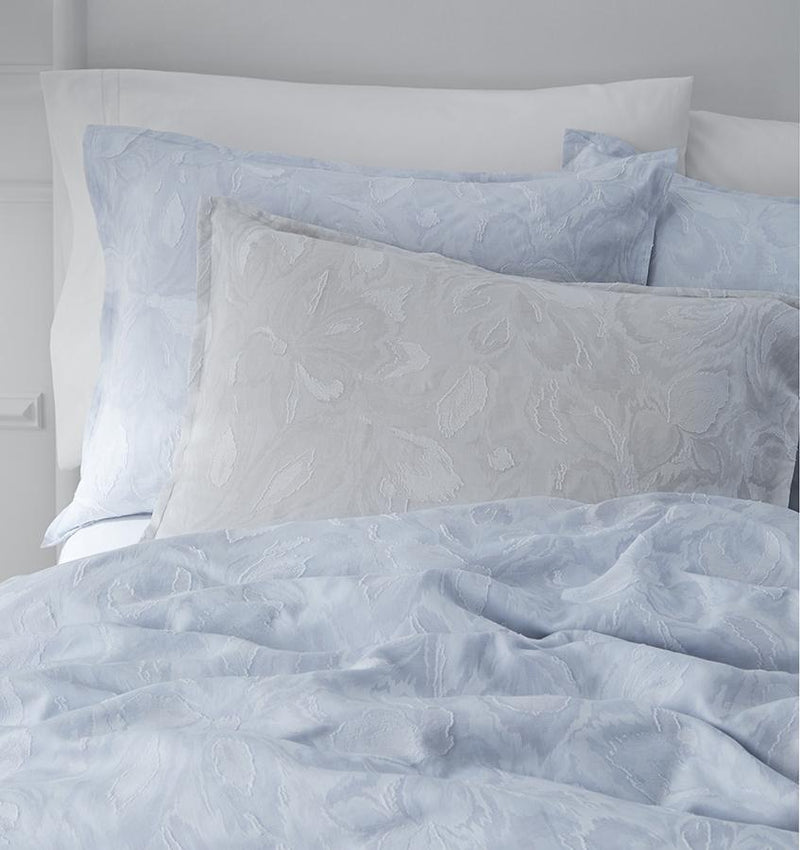 Giamina Duvet Cover features large fil coupé petals in muted, natural colors, giving the fabric a super-soft, textural effect.