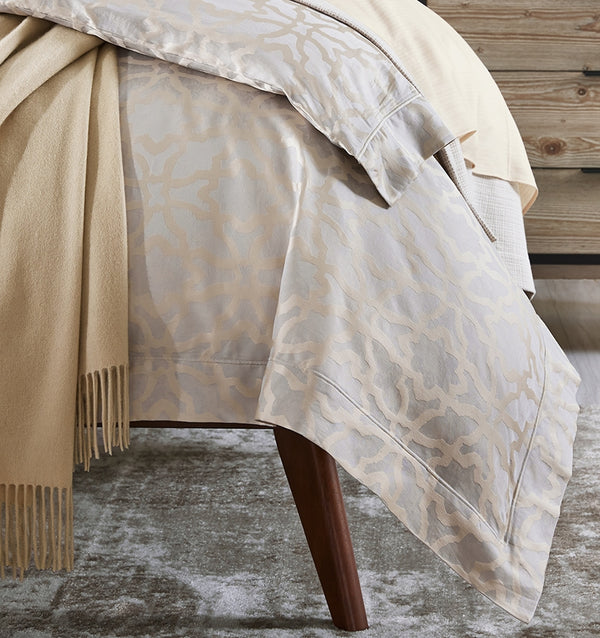 Giando Duvet Cover's classic geometric design, in Champagne-colored sateen, perfectly accents the faint shimmer of silver beneath.