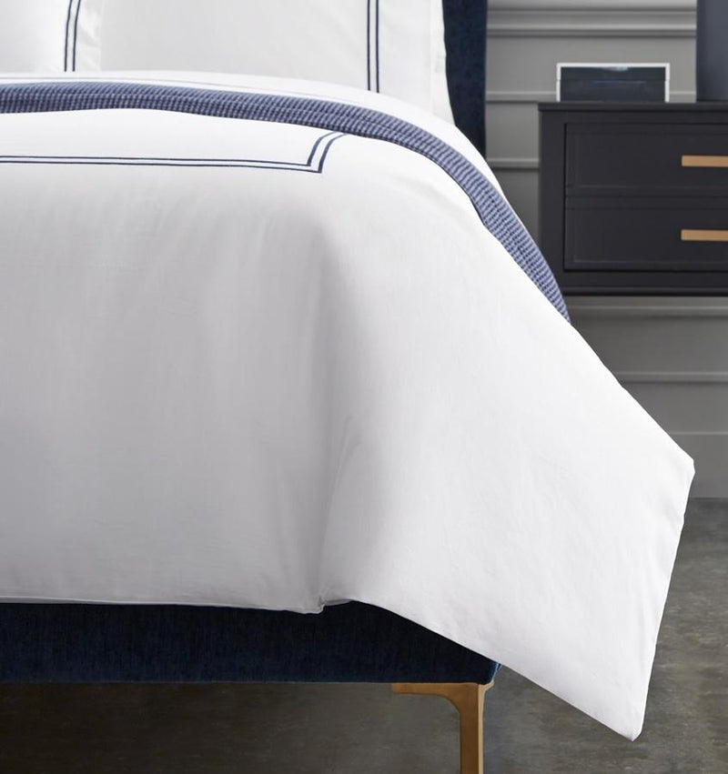 The SFERRA Grande Hotel Duvet Cover percale bedding is embroidered with double rows of satin stitch woven by our masters in Italy.