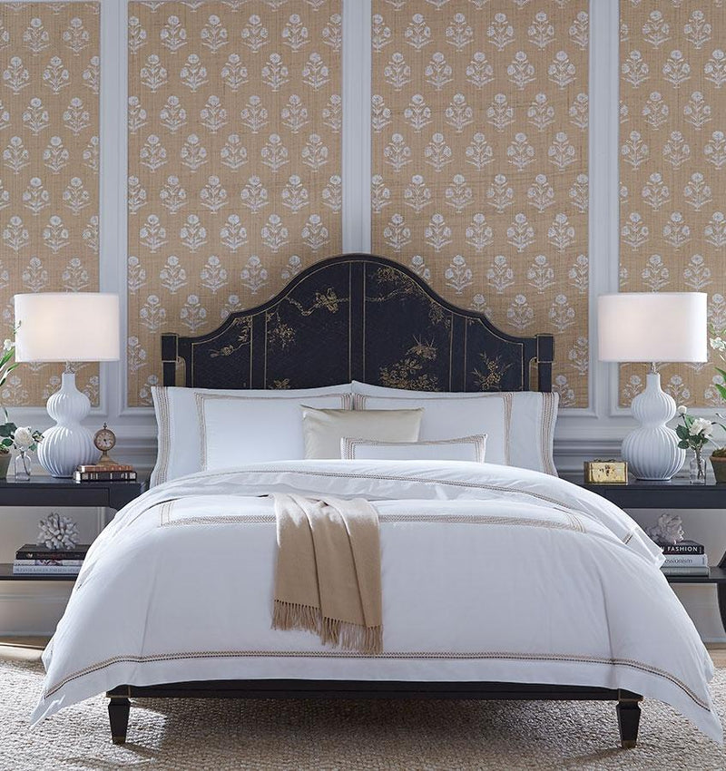 The SFERRA Intreccio Duvet Cover features embroidered stripes in golden or blue hues.