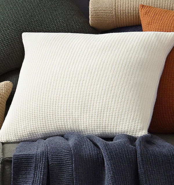 In a chunky lambswool knit, our Pettra decorative pillow is more than a welcoming spot to rest-it's an invitation to daydream in the comfort of its warmth.