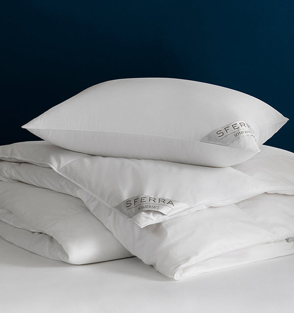 Filled with Polish white goose down and encased in a pure cotton sateen, the Somerset duvet and pillows keep their dreamy loft night after night.