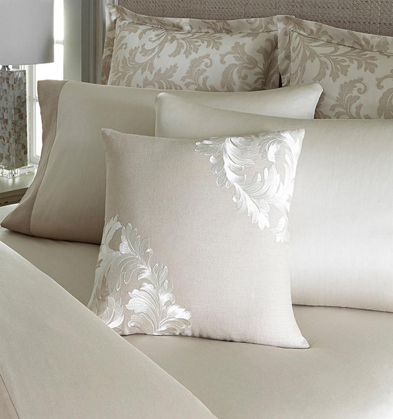 Teana Decorative Pillow features embroidery against a natural linen body for a classically elegant design.