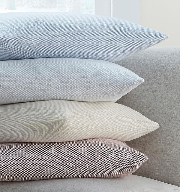Terzo pillows and throws feature a classic basket weave pattern in soft, versatile colors.