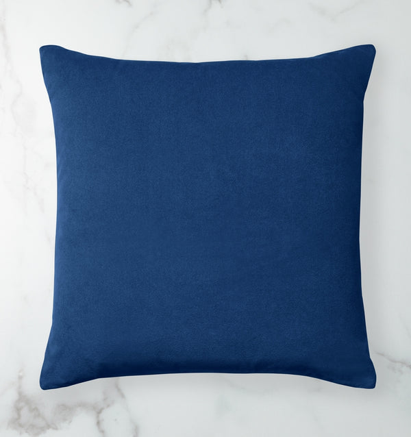 Velluto is a versatile, two-toned velvet decorative pillow in a rich color palette of blues, greys and beige.