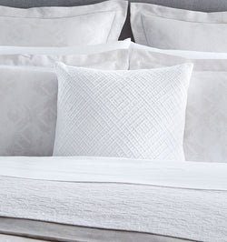 A classic diamond pattern reimagined, Traliccio's layered dual-tone embroidery lends delicacy and depth to any room.