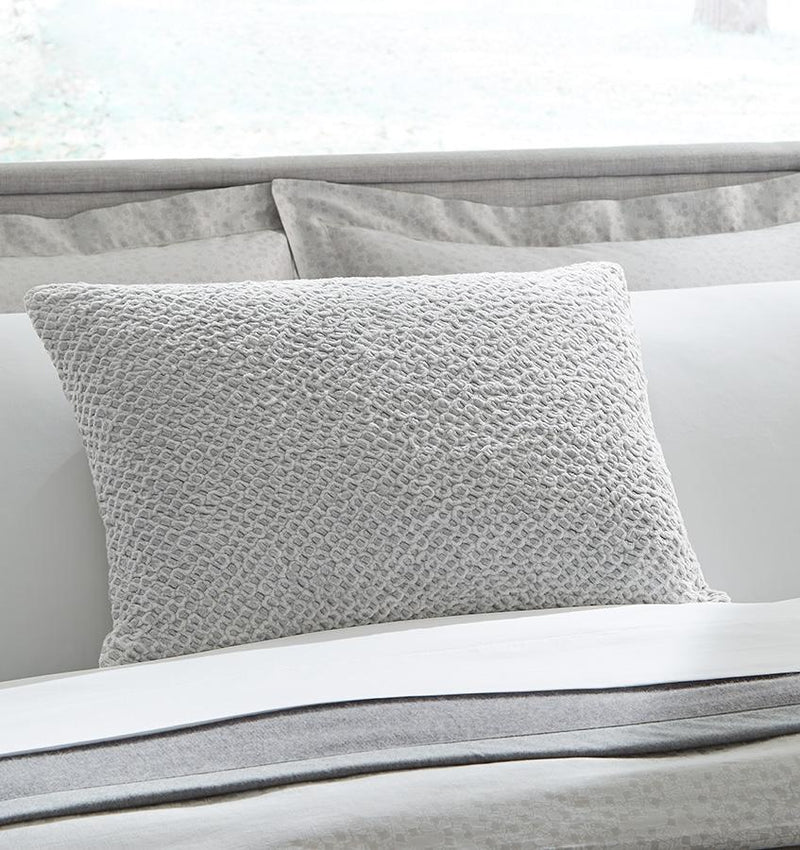 The Zea Decorative Throw Pillow features silver metallic threads interwoven throughout its intensely textured cotton knit.