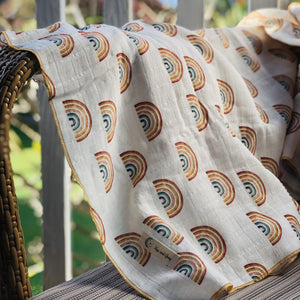 Rainbow muslin blanket draped over chair