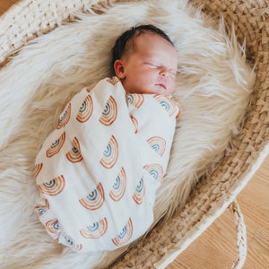 baby swaddled in an organic muslin blanket
