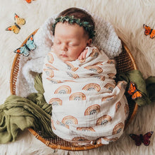 Load image into Gallery viewer, baby swaddled in an organic muslin blanket