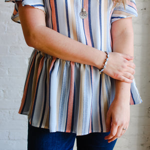 pastel striped peplum ruffle sleeve top