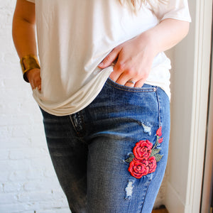 rose embroidered medium wash jeans