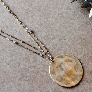 Hammered metal pendant necklace