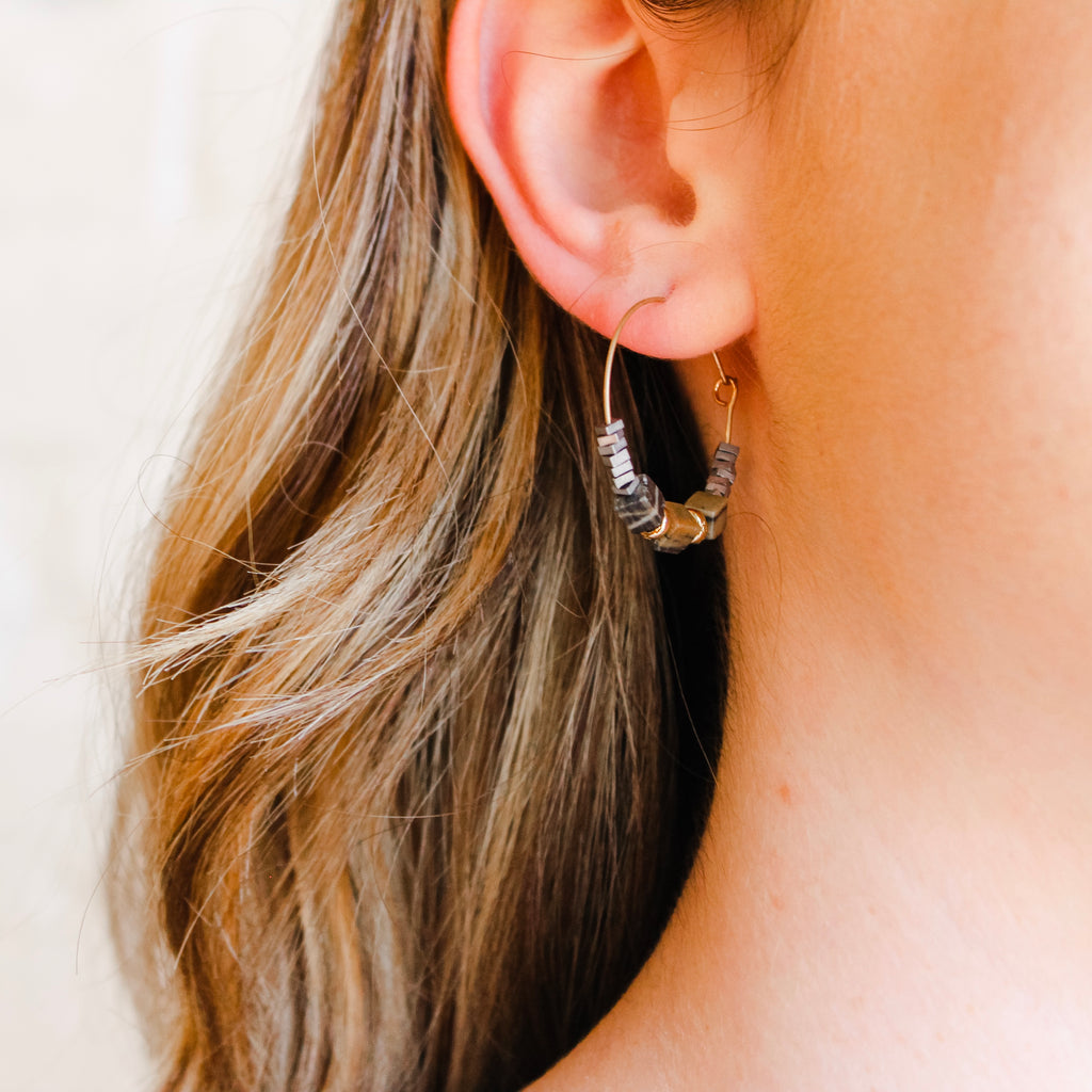 Gold mid size hoops with black and silver stones